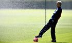 Arsène Wenger and some water.
