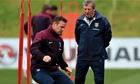 Wayne Rooney and Roy Hodgson of England