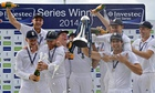 Captain Alastair Cook, front right, holds the Pataudi Trophy for England's series win against India.