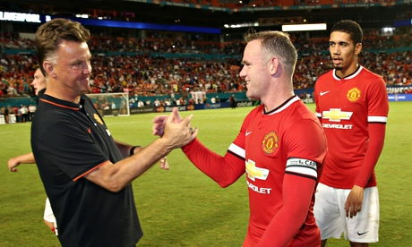 Louis van Gaal of Manchester United congratulates Wayne Rooney
