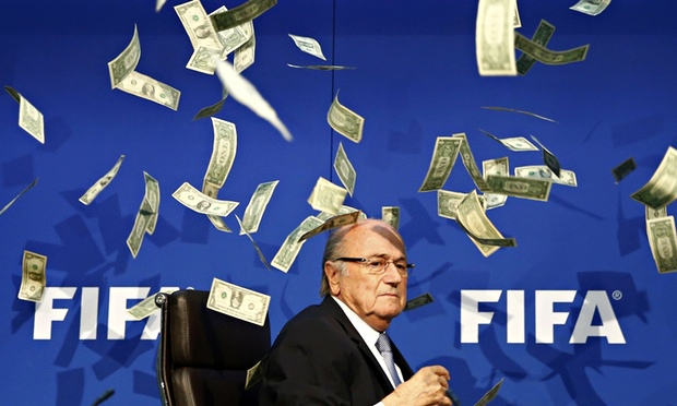 The Fifa president Sepp Blatter walked out of a press conference after being showered with fake dollar bills by the British comedian Lee Nelson.  Nelson, whose real name is Simon Brodkin, illegally gained entry to the Fifa headquarters in Zurich and poured dozens of fake banknotes over the stage around where Blatter was seated after announcing himself as a North Korean World Cup delegate.