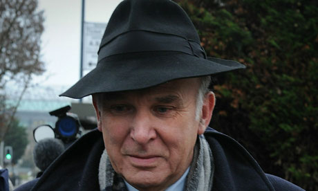 Vince Cable in hat