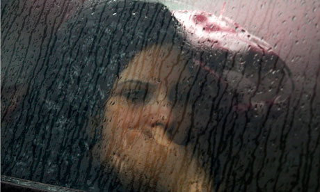 woman car rain 007 A judge on Friday extended Lohan's probation on drunken driving and other ...