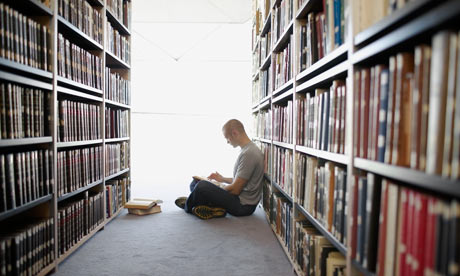 man reading library