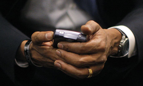 Barack Obama holds his BlackBerry