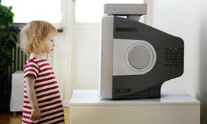A little girl watching TV