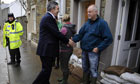 Gordon Brown speaks to a resident in Cockermouth