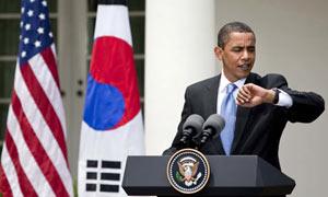 Barack Obama checks out his Jorg Gray