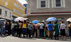 People seeking to withdraw funds line up outside the Bank of Antigua in St John's