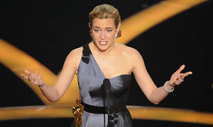 Kate Winslet accepts the Oscar for best actress for her work in The