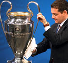  An UEFA official polishes the Champions League trophy