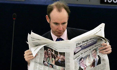 Daniel Hannan reads a newspaper during the Plenary session of the European Parliament
