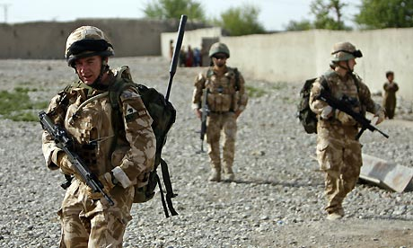 British soldiers on a joint foot patrol with US Marines in Musa Qala, Afghanistan