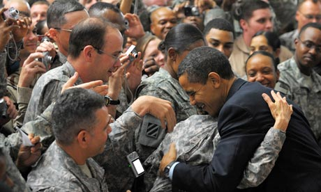 Barack Obama greets troops during a visit to Camp Victory, just outside Baghdad