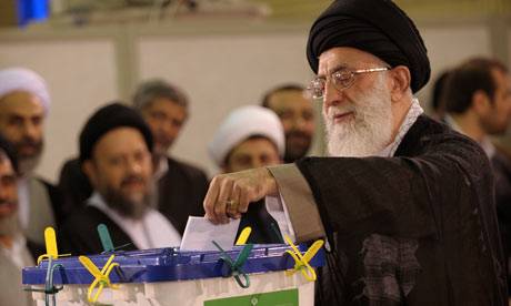 Ayatollah Ali Khamenei casts his vote to elect a new president in his office in Tehran