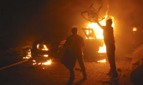 Activists burn furniture after setting on fire the house of Rita Bahuguna Joshi