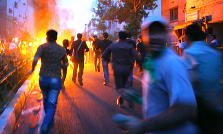 Supporters of Mir Hossein Mousavi run in the streets of Tehran in protests, June 16, 2009