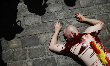 A protester demonstrates against bullfighting of the San Fermin festival in Pamplona