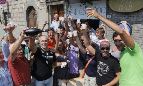 Residents of Bagnone, Italy celebrate winning the lottery