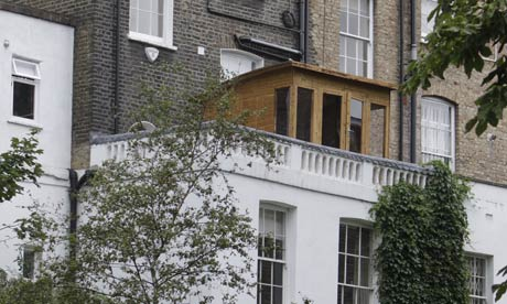 Boris Johnson has been forced to pull down a wooden summer house he built on the balcony of his home