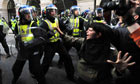 Riot police clash with G20 protestors in London on 1 April 2009