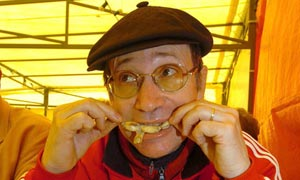 Dining on frogs' legs at the annual frog fair at Vittel, France