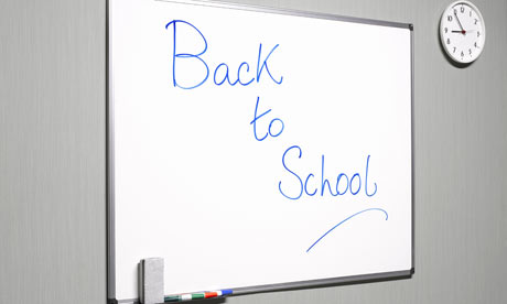 Back to school written on a whiteboard