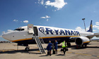 Ryanair crew stand in front of a passenger jet in Marseille