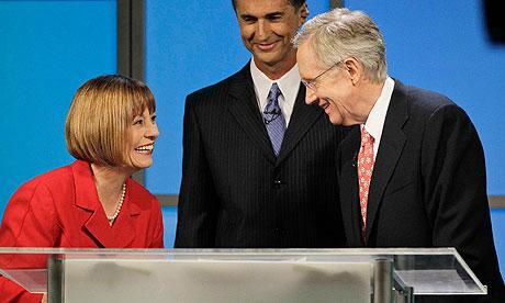 Sharron Angle and Harry Reid (r) speak after a TV debate during the Nevada Senate race.