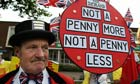 An activist protests against pension cuts outside the Conservative party conference in Birmingham.