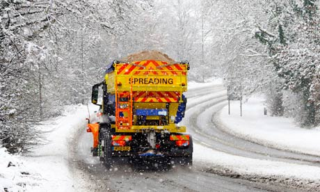 A gritting lorry near Farningham, Kent, as the predicted snow arrives in southeast England.