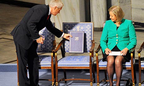 Nobel committee chairman puts the peace prize on the chair where winner Liu Xiaobo would have sat