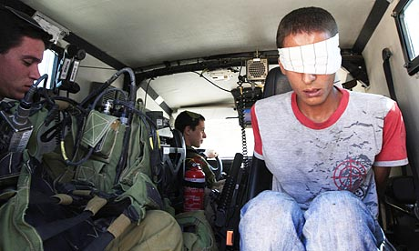 Palestinian held by Israeli soldiers