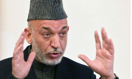 Afghanistan's President Hamid Karzai gestures during a news conference in Kabul
