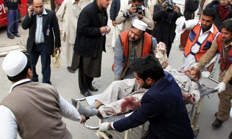 suicide bombing in pakistan causes A suicide bomber has killed at least 31 people near a polling centre as pakistanis  voted on wednesday in a knife-edge general election.