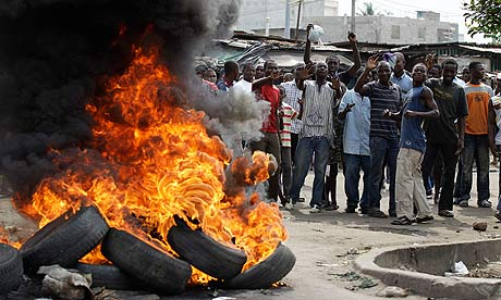 Supporters of Mr. Ouattara burn tires in Abidjan. (Photo Courtesy of AP).
