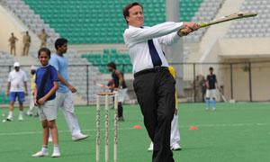 David Cameron playing cricket in India, July 2010