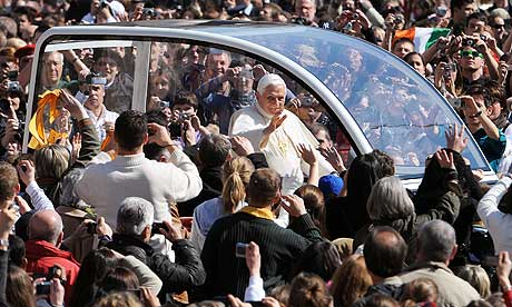 Pope Benedict XVI waves to faithful during his weekly general audience at The Vatican