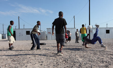 Youths playing football in Blikkiesdorp, Cape Town