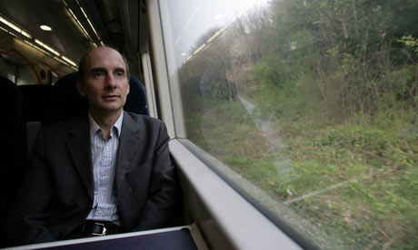 Lord Adonis, the transport secretary, on a train near Ashford International station, Kent.