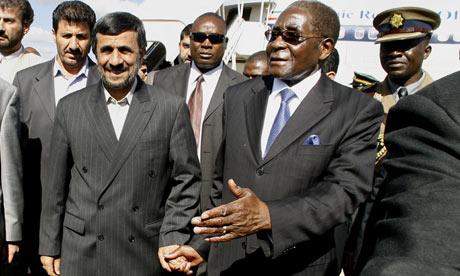 Robert Mugabe welcomes Mahmoud Ahmadinejad at Harare airport.