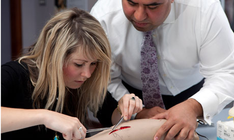 Perri Lewis learning to suture with Mr Akan Emin