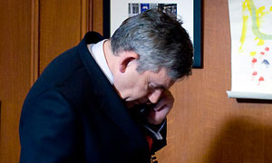 Gordon Brown takes the phone call from Nick Clegg  that decides his resignation