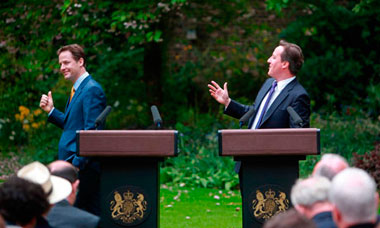 David Cameron and Nick Clegg hold a press conference in the garden of 10 Downing Street.