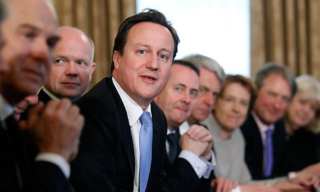 David Cameron leads his first cabinet meeting at No 10
