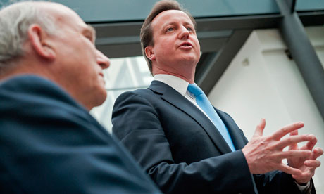 David Cameron, watched by Vince Cable, at the Department for Business, Innovation and Skills.