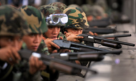 Soldiers take position near the Red Shirt protesters camp in Bangkok, Thailand