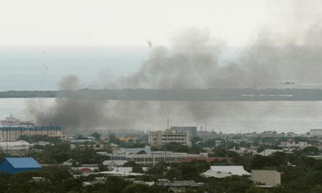 smoke biillows over Kingston amid police gunfights