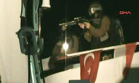 A screengrab from the Turkish aid group IHH claims to show Israeli soldiers storming the flotilla.