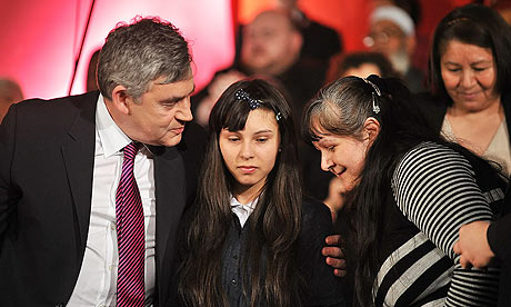 Gordon Brown hugs 14-year-old Tiara Sanchez, who broke down in tears during the Citizens UK event.